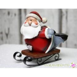 Lustiger Weihnachtsmann auf Schlitten